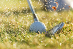 Chipping a golf ball onto the green with golf club. Royalty Free Stock Photos
