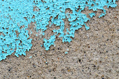 Chipping paint. Chipping blue paint on a concrete wall Royalty Free Stock Photography