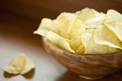 Chips. Wood bowl full of Chips Stock Photos