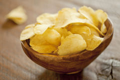 Chips. Wood bowl full  of Chips Royalty Free Stock Image