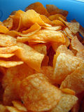 Chips. Tomato chips in blue bowl Stock Photography