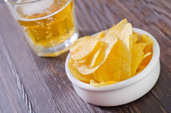Chips and beer Stock Photo