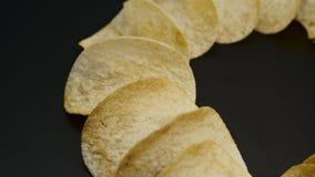 Chips on black, closeup Stock Photo