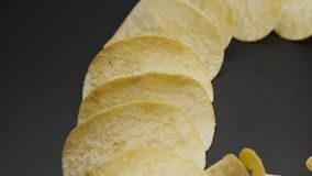 Chips on black, closeup stock footage