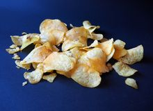 Chips on the blue background stock photos