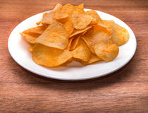 Chips in a bowl. On a wooden table Stock Photos