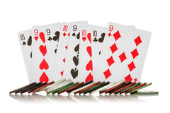 Chips and cards. For poker on white background royalty free stock photography