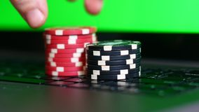 Chips for casinos on laptop, online casino concept