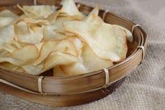 Chips Cassava. At natural sack cloth Royalty Free Stock Photos