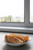 Chips. Cheese chips stand on the windowsill Royalty Free Stock Photos