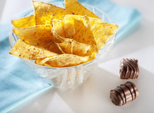 Chips and chocolates stock photos