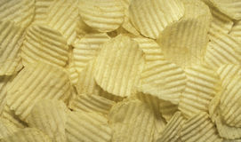 Chips. Close up crispy potato chips top view backgrounde. Ruffles form stock images