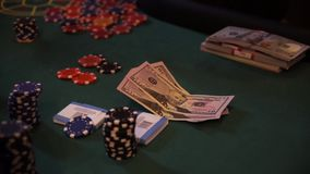 Chips and counterfeit money on casino table, playing roulette. stock footage