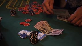 Chips and counterfeit money on casino table, playing roulette. stock video footage