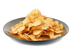 Chips crisps on plate. Isolated on white royalty free stock image
