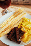 Chips, crispy crackers of black bread with sesame and sticks Royalty Free Stock Photography