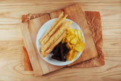 Chips, crispy crackers of black bread with sesame and sticks Stock Image
