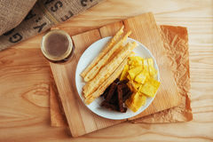 Chips, crispy crackers of black bread with sesame and sticks Stock Photos
