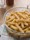 Chips in a Deep Frying Basket Royalty Free Stock Photos