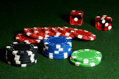Chips and Dice. Gambling chips and craps dice on gaming table Royalty Free Stock Photos