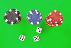 Chips and dice on green Royalty Free Stock Images