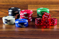 Chips and dice on a table Royalty Free Stock Photography