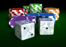 Chips and dices. Colorful chips on a green table Stock Image