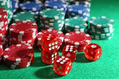 Chips and dices on green table royalty free stock photo