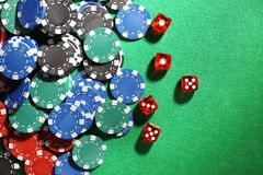 Chips and dices on green table royalty free stock image