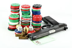 Chips dices money and gun Stock Photo