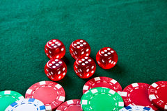 Chips and dices on the table. Royalty Free Stock Image