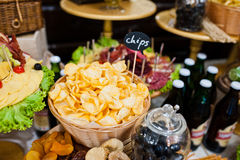 Chips with different beer on wedding reception. Royalty Free Stock Photos
