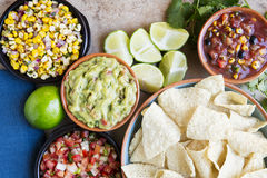 Chips and Dipping Sauces. Tortilla chips served with guacamole, salsa, and pico de gallo, view from above