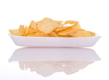 Chips on dish. A white background Stock Photos