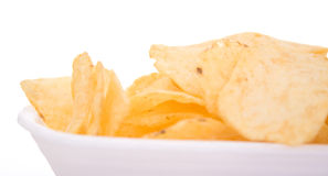 Chips on a dish. White background Royalty Free Stock Photography