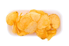 Chips on dish. A white background Royalty Free Stock Photo
