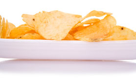 Chips on dish. Chips on dish a white background. macro Royalty Free Stock Photography