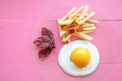 Chips with egg Royalty Free Stock Images