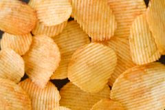 Chips food background wavy ridged potato crisp mix stock photo