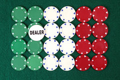 Chips forming the italian  flag. Poker chips forming the italian  flag and dealer button Royalty Free Stock Photos