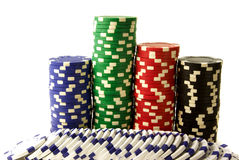 Chips for gambling. Blue green red black and white chips isolated over white background Royalty Free Stock Photography