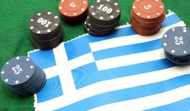 Chips for gambling over the flag of Greece Stock Photos