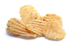 Chips with greens. Couple of golden chips with greens isolated on white royalty free stock images