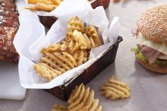 Chips and hamburger Royalty Free Stock Photos