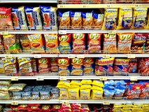 Chips and junk food sold in a grocery Stock Photos