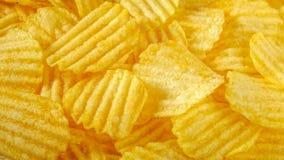 Chips, Kartoffellebensmittelhintergrund Stockfoto
