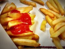Chips with ketchup. Close-up of chips with kétchup sauce in a restaurant in Asturias, Spain Royalty Free Stock Image
