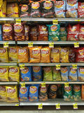 Chips line the aisle of a grocery store Stock Images