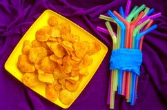 Chips make good company for viewing movies, TV series, a day off. For rest royalty free stock image