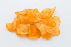 Chips med paprica på en vit bakgrund Royaltyfria Foton